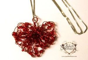 Heart pendant with red wire and beads on sterling silver chain
