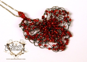 Heart Pendant, oxidized silver wire with red glass beads.  Available with a sterling silver chain or a black velvet
