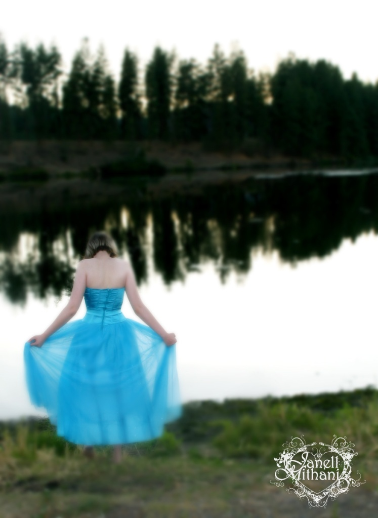 photograph of girl in blue dress by lake by janell mithani