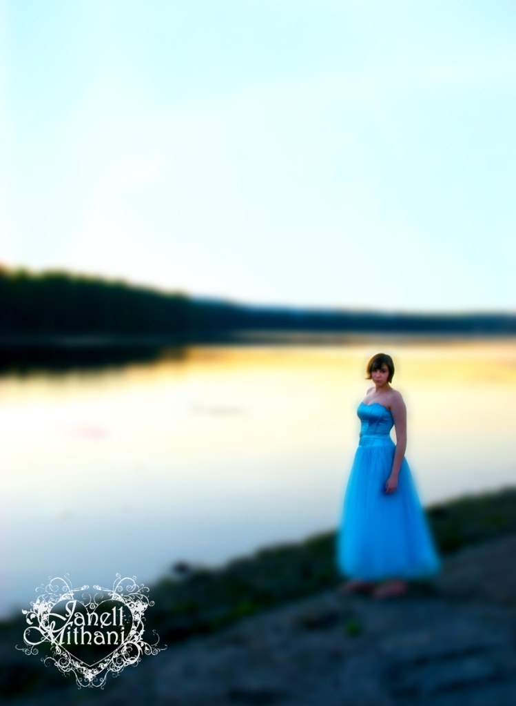 photograph of girl in blue dress at lake by Janell Mithani