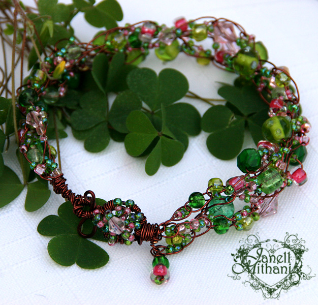 Green, pink and copper crocheted bracelet by Janell Mithani