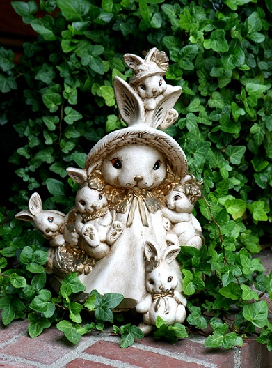photograph of mother bunny and children garden sculpture by Janell Mithani