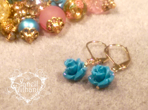 Blue flora earrings by Janell Mithani