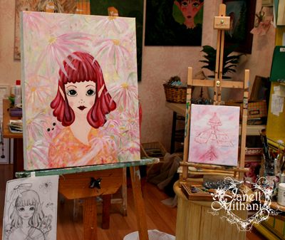 working on two paintings in the studio by janell Mithani
