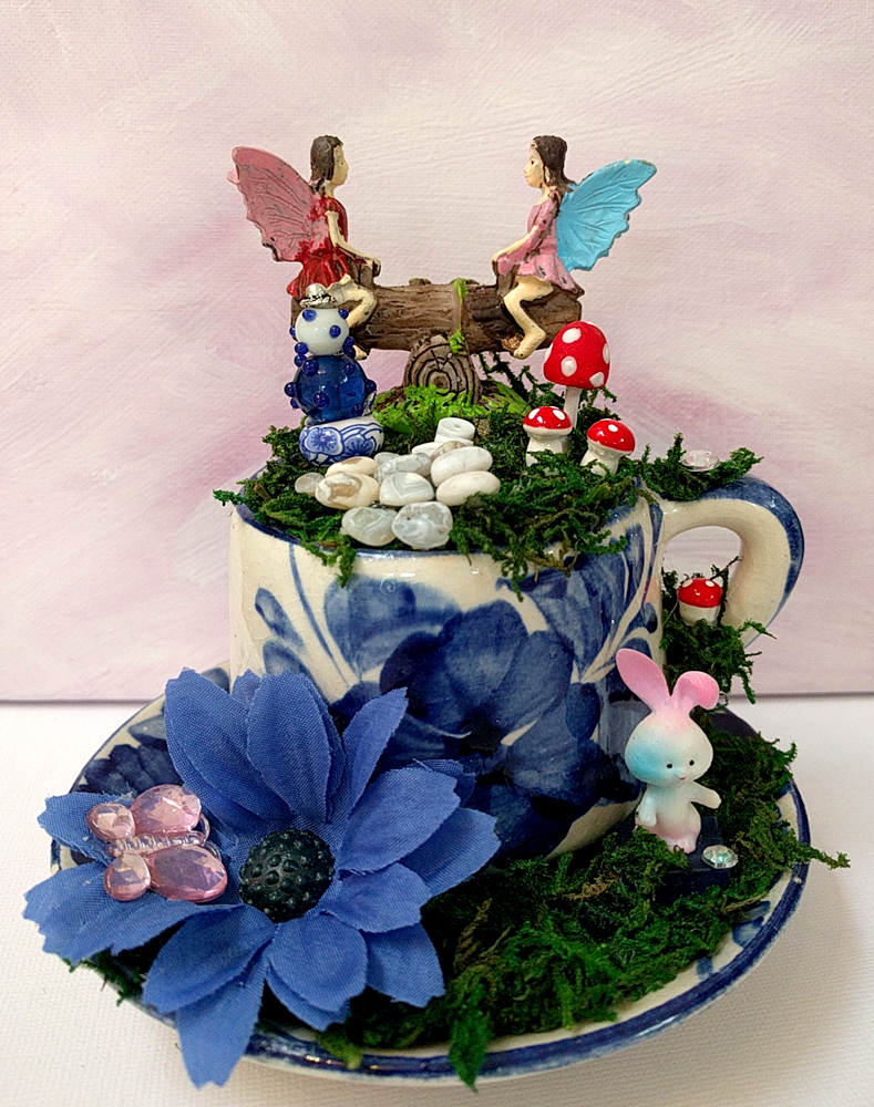 blue and white tea cup fairy garden by Janell Mithani