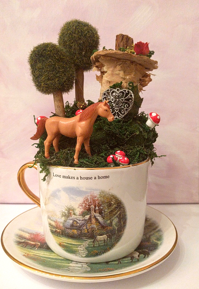 Horse fairy garden in Thomas Kinkade tea cup and saucer by Janell Mithani