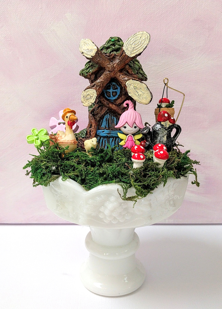 Fairy garden in a milk glass dessert cup by Janell Mithani