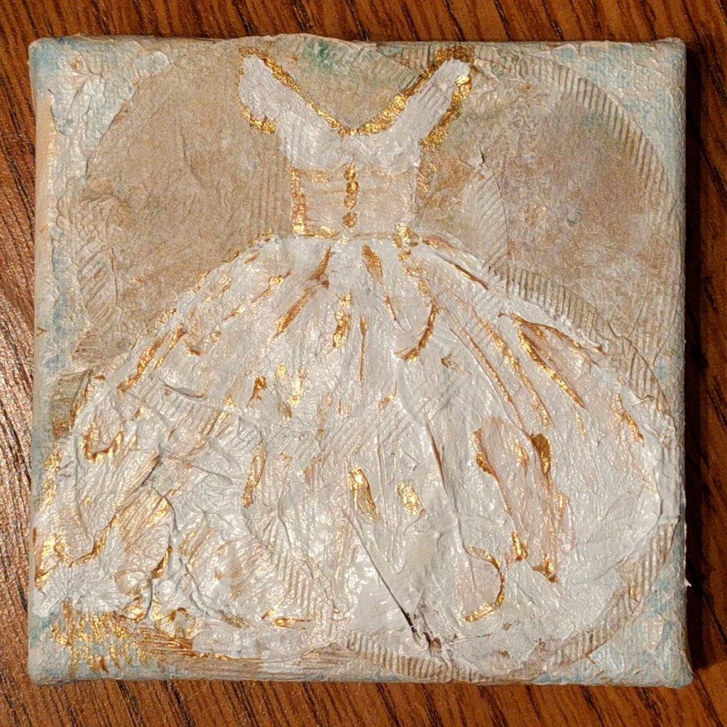 gold and white dress painting on recycled tea bag